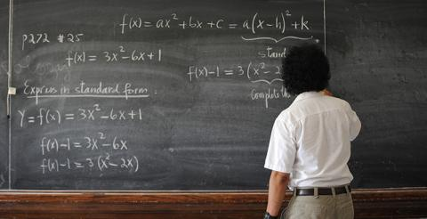 Student with Chalkboard Equation